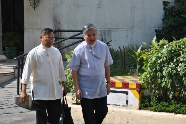 Archbishop Socrates Villegas of Lingayen-Dagupan walks back to the plenary hall at Pope Pius XII Catholic Center after a break in the 2012 plenary assembly of the Catholic Bishops' Conference of the Philippines which he now serves as President. - NJ Viehland Photos